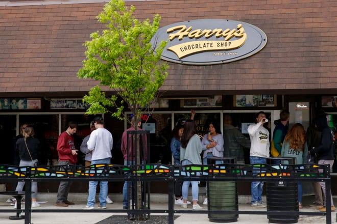 Customers line up outside Harry's Chocolate Shop on State Street, Monday, May 11, 2020 in West Lafayette.