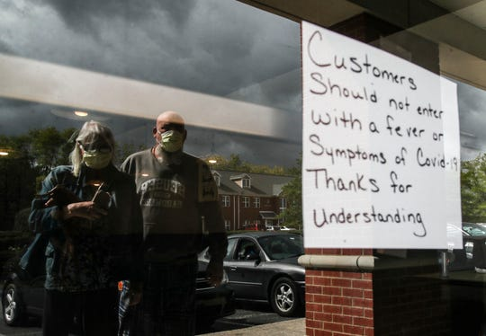 A sign warns customers outside Angie's Cafe in Jeffersonville.