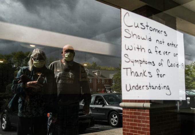A sign warns customers outside Angie's Cafe in Jeffersonville. After Indiana government shut down dining rooms in restaurants to curb Covid-19, Monday saw restaurants reopen at 50 percent capacity. May 11, 2020