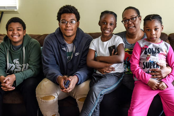 Angelia Clark with her children, from left, Jeremiah Clark, 14, Mehki Jordan, 17, and 6-year-old twins A'Nailah and A'Naijah Clark, photographed on Monday, May 11, 2020, at their home in Lansing. Angelia is navigating the challenges of working from home, and caring and homeschooling her four children.