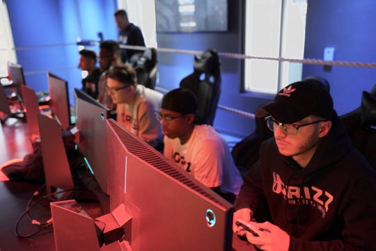 Grizz Gaming players, from left, Joel Lazu, Mehyar Ahmed-Hassan, Daniel Davis, Dayvon Curry and Zach Vandivier practice at the team's facility across from FedExForum earlier this year.