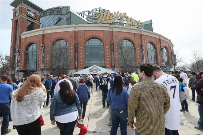 Fans head into Miller Park for the Milwaukee Brewers' 2019 home opener at against the St. Louis Cardinals on March 28, 2019. When, or if, the Brewers have their home opener in 2020, chances are they will be playing to empty stands.