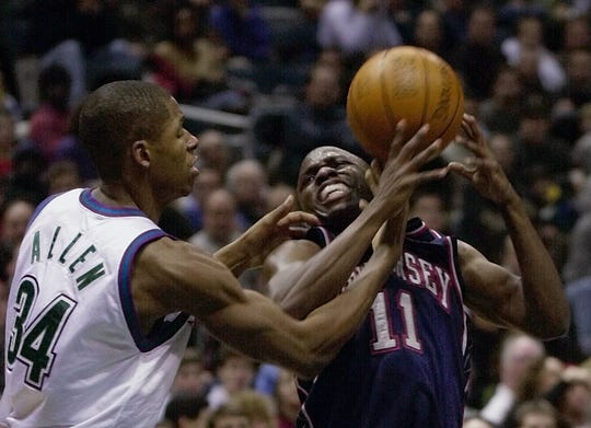 Milwaukee Bucks' Ray Allen (34) fouls New Jersey Nets' Sherman Douglas (11) as he goes up for a shot in the second quarter Thursday, Dec. 21, 2000, in Milwaukee.