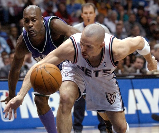 New Jersey Nets' Jason Kidd, right, beats Milwaukee Bucks' Gary Payton to a loose ball during the second quarter of the first-round playoff game Saturday, April 19, 2003, in East Rutherford, N.J. The Nets beat the Bucks, 109-96.