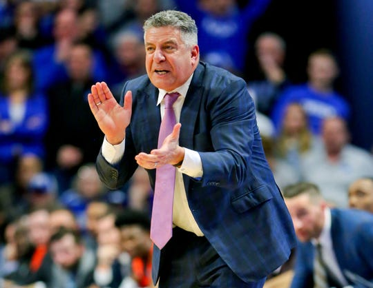 Auburn coach Bruce Pearl claps during a game against Kentucky at Rupp Arena on Feb. 29, 2020 in Lexington, KY.