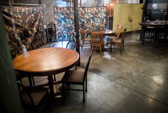 Staff at Elm Street Brewing Co. increased space between seating areas, taped off tables and positioned tarps in dining areas in order to encourage social distancing after reopening.