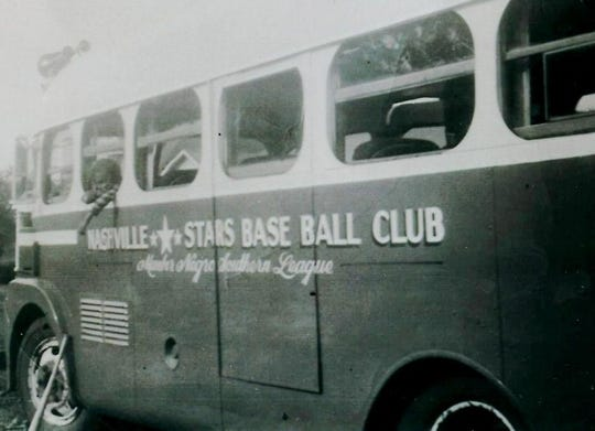 The three-stars logo used by the Nashville Stars team in the Negro Leagues can be seen on the side of the team bus.