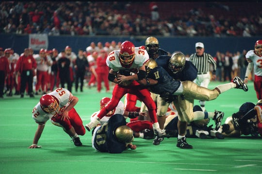 Joe Dawkins of Hackensack makes a tackle during a 1994 game at Giants Stadium.