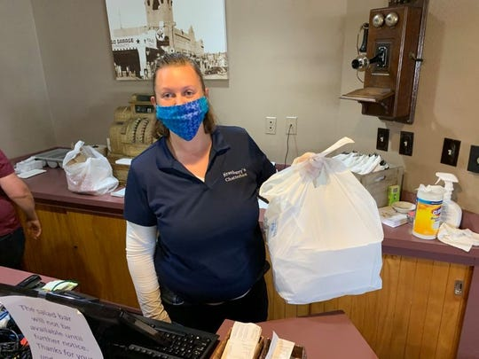 Kaitlin Thornock finishes bagging a lunch order for pickup at Kranberry's Restaurant in Lordsburg, New Mexico on Friday, May 8, 2020.