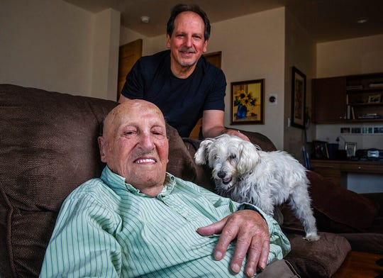 In this Wednesday, May 6, 2020, photo, 108-year-old Phil Corio poses with his son Ron Corio, in Albuquerque. Both were infected with the new coronavirus and Phil just might be the oldest person in the world to survive COVID-19.