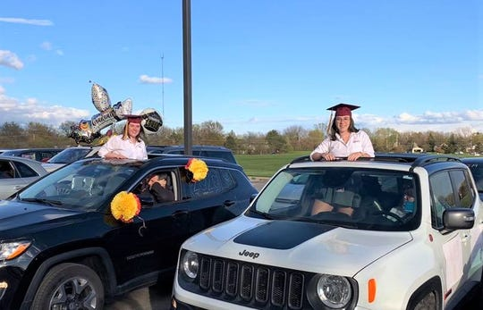 Students remained in their cars with family as staff congratulated them on the milestone.