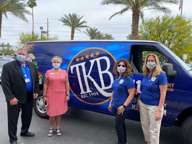 Gary Honts, CEO of JFK Memorial Hospital, joined Bonnie Tucker, Woman's Club of Indio President; board member Gloria Franz and Elaine Holmes, Indio Mayor Pro Tem and WCI club member for the delivery.