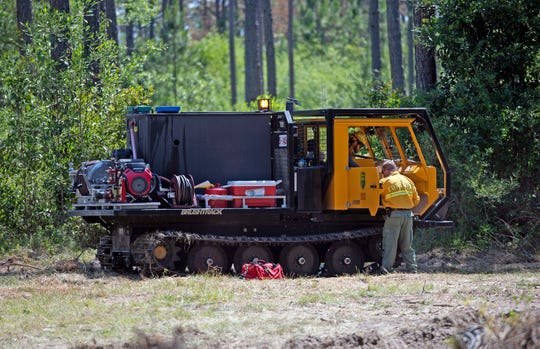The Florida Forest Service continues work Monday to fully contain the Hurst Hammock Fire. The 1,200-acre wildfire was about 75% contained Monday.