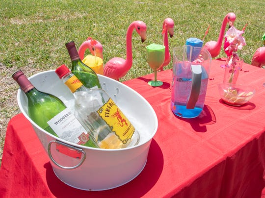 Robb Guadagni and David Nealey's flamingo display of the day is Cinco de Mayo themed in front of their home on Summitt Boulevard in Pensacola on Saturday, May 8, 2020.