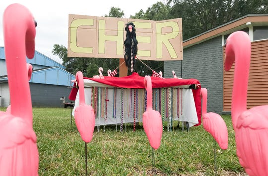 Robb Guadagni and David Nealey's flamingo display of the day is Cher themed in front of their home on Summitt Boulevard in Pensacola on Saturday, May 8, 2020.