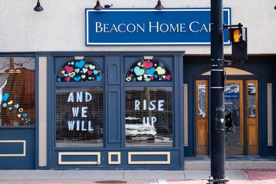 The windows at Beacon Home Care in downtown Port Huron are decorated with an inspirational message Tuesday, April 14, 2020.