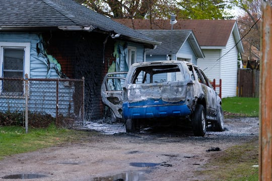 A vehicle caught fire in the 1400 block of 20th Street and spread to a neighboring home.