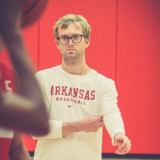 Former New Oxford boys' basketball coach Sean Bair is shown here during a University of Arkansas men's basketball practice. Bair joined the Razorbacks' staff last season as a graduate assistant coach.