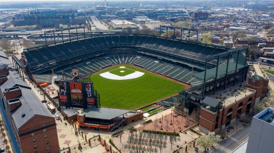 In this aerial photo, Oriole Park at Camden Yards is closed on what would've been Opening Day, Thursday March 26, 2020, in Baltimore. The Orioles' season could start in early July, but if that happens, there likely won't be any fans in the stands.
