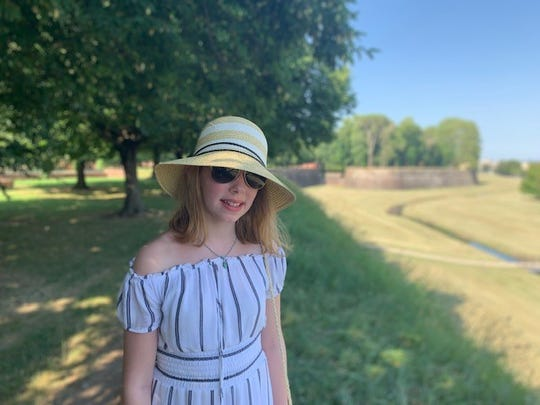 Keira Woods was in a town near Florence, Italy, in this photo from last summer. She's 13, just days out of the hospital on this trip.