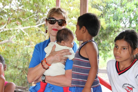 Barbara Land visits with the children of Ayacucho, Peru during a trip to the Amazon Rainforest. Land, founder and executive director of the Nevada Building Hope Foundation, often visits remote river villages to provide aid to the local residents there.