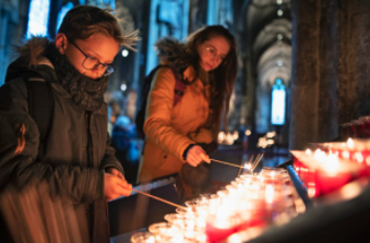 Some churches are offering mourners a virtual way to light candles and mourn for their loved ones.