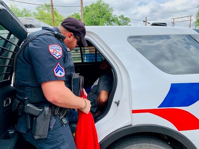Officers with the San Angelo Police Department arrest a 17-year-old charged with fleeing from the scene of a crash. May 11, 2020.