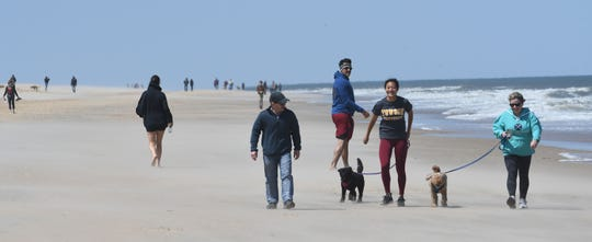 Folks have fun on the beach  in Ocean City Sunday, May 10, 2020 after the town  opened the beach and Boardwalk that had been closed since mid-March due to  the COVID-19 pandemic.