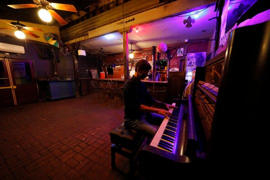 Pianist Josh Paxton performs a livestream concert from inside the closed and empty Maple Leaf Bar in New Orleans, Wednesday, April 29, 2020.