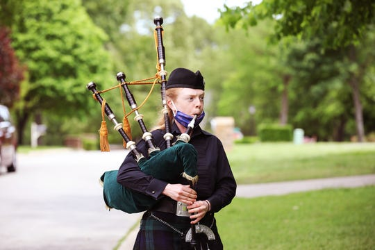 The School of the Ozarks seniors is honored with music by bagpiper Amanda Kershaw, administrators in regalia, signs, and special gifts May 7, the originally scheduled date of graduation.