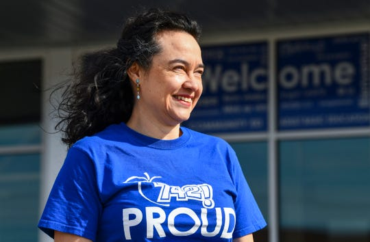 Mónica Segura-Schwartz smiles in front of the entrance to Quarryview Education Center Thursday, May 7, 2020, in Waite Park.