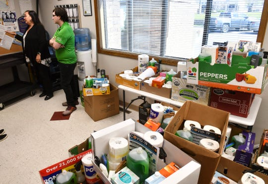 Executive Director Cara Ruff and marketing and development manager Shawn Reagan stand near dozens of completed care packages Monday, May 11, 2020, at Independent Lifestyles Inc. in Sauk Rapids.