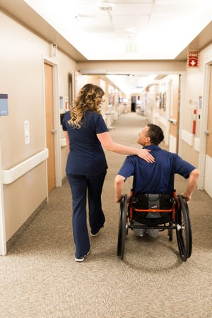 A nurse leads a patient down a hallway in this submitted photograph from Intermountain Healthcare. This past week, Intermountain Hospitals throughout the state joined in honoring nurses for their unique and important contributions.