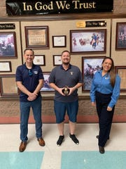 Kenny Kunde, center, receives a Golden Apple Award from the St. George Chapter of the BYU Alumni organization. Kunde is a teacher at Snow Canyon High School.