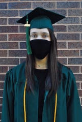 Lincoln High School graduate Rachel Hecker wears a face mask along with a cap and gown.
