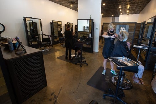Five Eight Five Zero Salon stylists are currently working at a time as barbershops and hair salons re-open Monday, May 11, 2020.