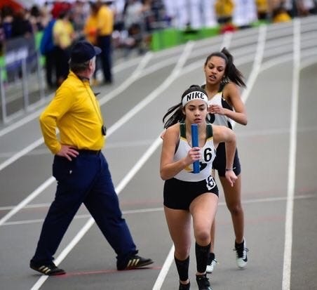 Bella Martinez of Vineland, (front), a member of Our Lady of Mercy Academy's track team, is participating in OLMA's Keep Playing for the W.I.N. effort, which will help send a meal package to a local front line hero or a family in need through local community organizations.