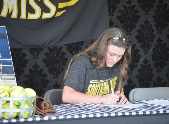 Former Central Valley Christian pitcher Rylie Atherton signed to play college softball at Southern Miss on Friday in Visalia.