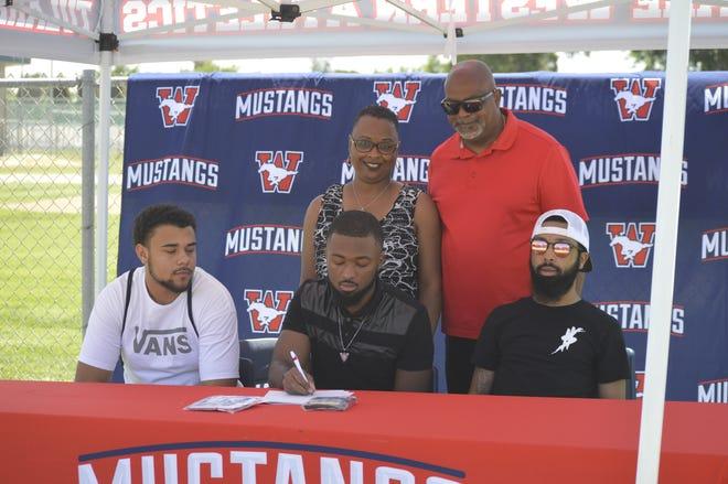 Tulare Western High School senior Mark Smith, center, will run track in college at Fresno Pacific.