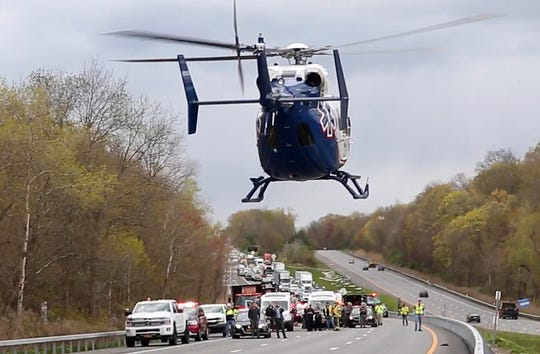 A LifeNet helicopter lifts off from northbound I-684 in the town of Southeast after a DOT worker was struck by a vehicle in the area of the northbound rest area May 11, 2020.