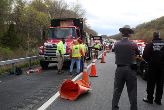 New York State Police investigate the scene where a worker was struck by a vehicle in the area of the northbound rest area on I-684 in Southeast May 11, 2020.