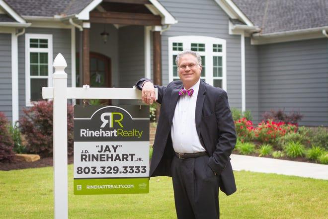 John Rinehart, Jr. in front of a listing in  Rock Hill, South Carolina.