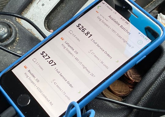 Instacart shopper Jeff Mitchell's iPhone displays the amount of money he would earn for accepting shopping assignments in Boulder County, Colorado.