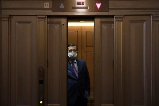 Sen. Ted Cruz, R-Texas, wears a face mask while riding an elevator in the U.S. Capitol.
