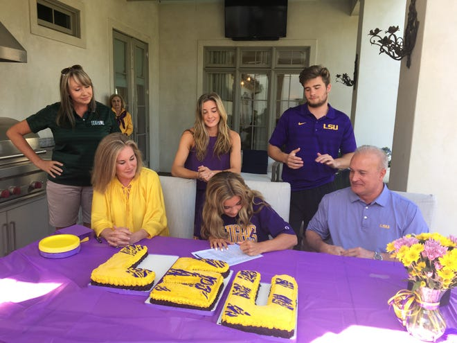 Menard senior Claire Vaughn (bottom row, center) signs her National Letter of Intent to LSU's track and field team Monday.