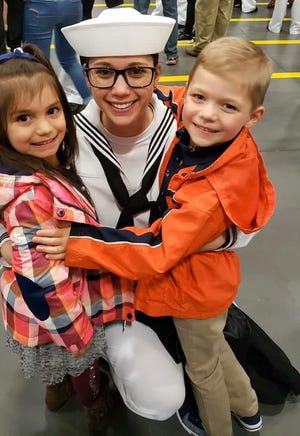 Rene Zehr, a hospital corpsman in the U.S. Navy Reserves, is pictured with her children. Zehr was deployed to treat coronavirus patients in New York in April.