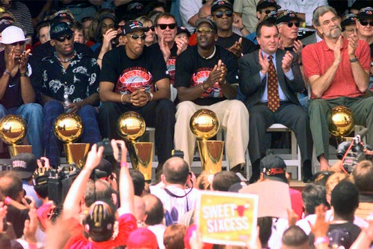 NBA Champions, from left: Ron Harper, Dennis Rodman, Scottie Pippen, Michael Jordan and coach Phil Jackson are joined on stage by Chicago Mayor Richard Daley, second from right, during a city-wide rally in Chicago to celebrate the Chicago Bulls 6th NBA championship in 1998.