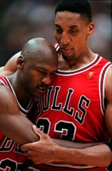 Chicago Bulls Scottie Pippen, right, embraces an exhausted Michael Jordan following their win in Game 5 of the 1997 NBA Finals against the Utah Jazz, in Salt Lake City. The flu-like illness Jordan fought through to lead the Bulls to a crucial victory in the 1997 NBA Finals created instant fodder for the virtue of perseverance.