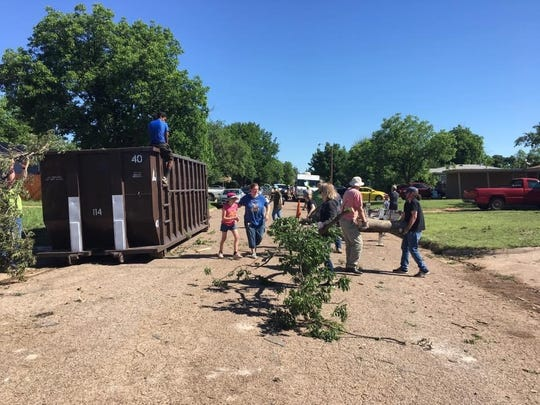 Community members in west Abilene provide cleanup effort in the aftermath of the May 18 tornado.