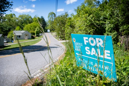 The supply of homes for sale in and around Asheville remains tight. A sign advertises a house on the market in South Asheville on May 11, 2020.
